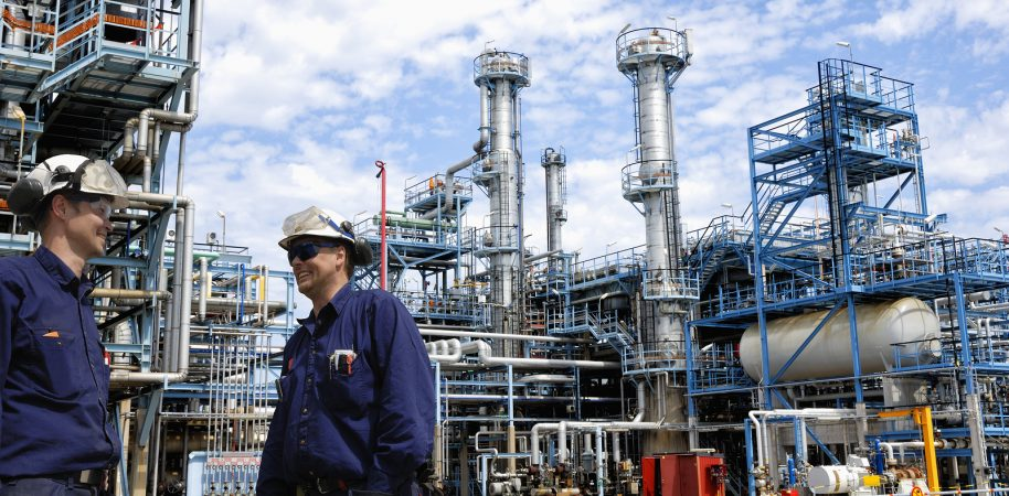 bigstock-refinery-workers-inside-large-107705423-e1470024962541
